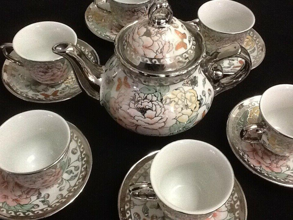 13 Pc Tea Set _ Tea Pot _ 6 Cups & Saucers w/ Rack. Silver M
