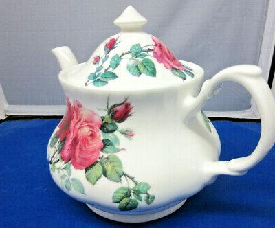 SALE**ENGLISH SET, TEAPOT & SAUCERS ENGLAND